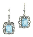These lovely reproduction sterling silver earrings are set with dazzling emerald cut blue topaz stones mounted in sterling filigree settings