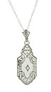 A rectangular Austrian crystal is surrounded by ornate sterling silver filigree on this sterling silver necklace