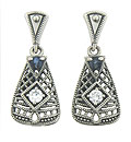 These elegant sterling silver earrings feature a weblike filigree