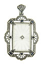A rectangular piece of Austrian crystal is set in this lovely filigree pendant/pin