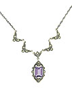 This sparkling pendant necklace is set with a dazzling emerald cut amethyst