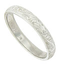 This elegant 14K white gold mens wedding band is decorated with intricate organic engraving