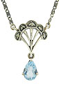 A pear shaped blue topaz is set in sterling silver with marcasite accents on this sterling silver necklace