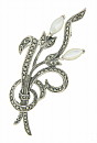 This sterling silver antique style pin is fashiones as a pair of waving flowers