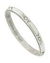 This elegant antique style platinum wedding band is adorned with a ribbon of deeply engraved blossoms