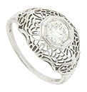 Elaborate floral filigree adorns the sides and shoulders of this phenomenal antique style engagement ring