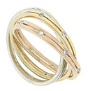A trio of 14K red, white and yellow gold bands set with fine faceted diamonds entwine to form this amazing estate wedding band
