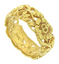 A romantic tumble of richly engraved flowers covers the face of this 14K yellow gold wedding band
