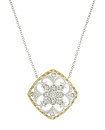 A frame of 14K yellow gold surrounds organic filigree frosted with fine faceted diamonds on this antique style pendant