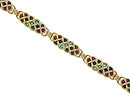 Elongated links of twisting 14K yellow gold are adorned with round cut sapphires, rubies and emeralds on this estate bracelet