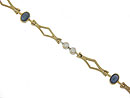 A trio of cabochon sapphires and pairs of fine faceted diamonds adorn the face of this 14K yellow gold vintage bracelet