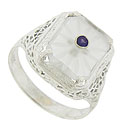 A rectangular piece of Austrian crystal is set in the face of this lovely filigree ring
