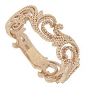 Lacy curling ferns cover three quarters of this 14K pink gold antique style floral wedding band