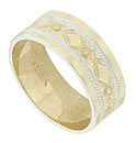 Diamond and floral shapes alternate around the circumference of this 14K yellow gold antique wedding band