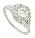 This antique style engagement ring is set with a dazzling GIA certified, .60 carat, F color, Vs1 clarity round cut diamond