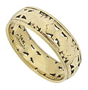 This elegant 14K yellow gold antique wedding band is decorated with abstract organic cutwork, intricate engraving and distinctive milgrain