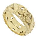 Intricately engraved blossoms and bold leaves dance across the surface of this 14K yellow gold wedding band
