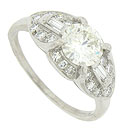 A fantastic EGL certified, 1.29 carat, H color, Si2 clarity, round cut diamond glows from the face of this antique style engagement ring