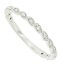 This elegant 14K white gold wedding band features a pattern of twisting milgrain