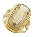 A spectacular emerald cut citrine is the focus of this elegant yellow gold estate ring