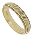 Deeply engraved ridges adorn the surface of this 14K yellow gold wedding band