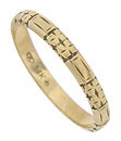 Deeply engraved abstract floral decorations adorn the surface of this antique wedding band