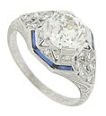 This phenomenal antique engagement ring features a fiery 1.48 carat, GIA certified, I color, Vs1 clarity round cut diamond