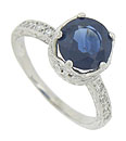A stunning 2.83 carat sapphire rises from the face of this platinum engagement ring