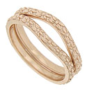 These curved 14K red gold antique style wedding bands are covered with floral designs in subtle relief