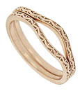 These curved 14K red gold antique style wedding bands are covered with impressed vines and berries