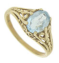 Bold 10K yellow gold organic filigree winds across the sides and shoulders of this antique ring