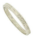This lovely antique style wedding band is engraved with trios of abstract blooms