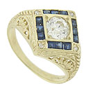 This spectacular 14K yellow gold engagement ring features a square face set on edge