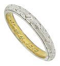 This elegant antique wedding band is crafted of platinum and 18K yellow gold