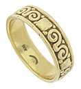 This handsome 14K yellow gold wedding band is adorned with bold scrolling figures and enlarged milgrain decoration