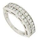 A double row of dazzling round cut diamonds adorn the face of this 14K white gold estate wedding band