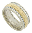 This sparkling and unique 14K bi-color wedding band features a richly engraved yellow gold floral band framed in strings of channel set diamonds