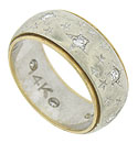 Celestial engravings cover the face of this 14K bi-color estate wedding band