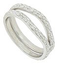 These curved 14K white gold antique style wedding bands are covered with floral designs in subtle relief