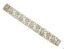 Sterling silver frames filled with delicately engraved cutwork roses form the links on this vintage bracelet