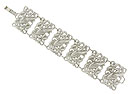 Wide links of abstract floral cutwork dance across the face of this sterling silver antique style bracelet