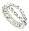 These curved 14K white gold antique style wedding bands are covered with curling vines and leaves