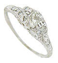 This exquisite antique engagement ring is set with a luminous .32 carat, mine cut diamond
