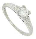 This captivating platinum vintage engagement ring is set with a luminous .38 carat, EGL certified, G colored, Vs1 clarity round cut diamond