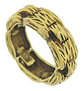 Bold, deeply engraved figural links surround the surface of this vintage 18K yellow gold wedding band