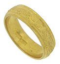 This exquisite estate wedding band is crafted of 24K yellow gold and covered with intricate organic engraving