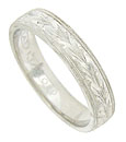 This elegant platinum Tacori wedding band features a richly engraved organic design