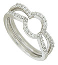 These antique style 14K white gold curved wedding bands are set with diamonds