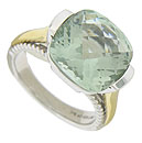 A spectacular multi-faceted green amethyst glows from the face of this elegant sterling silver ring