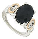 A spectacular multi-faceted oval cut onyx adorns the face of this antique style sterling ring